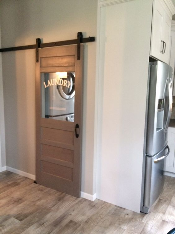 small laundry with barn door