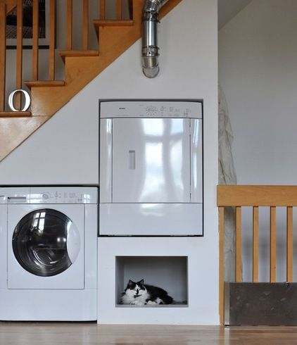 washer and dryer under the stairs