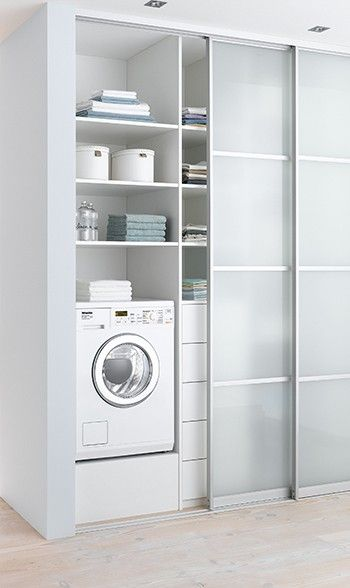 white modern laundry with sliding door