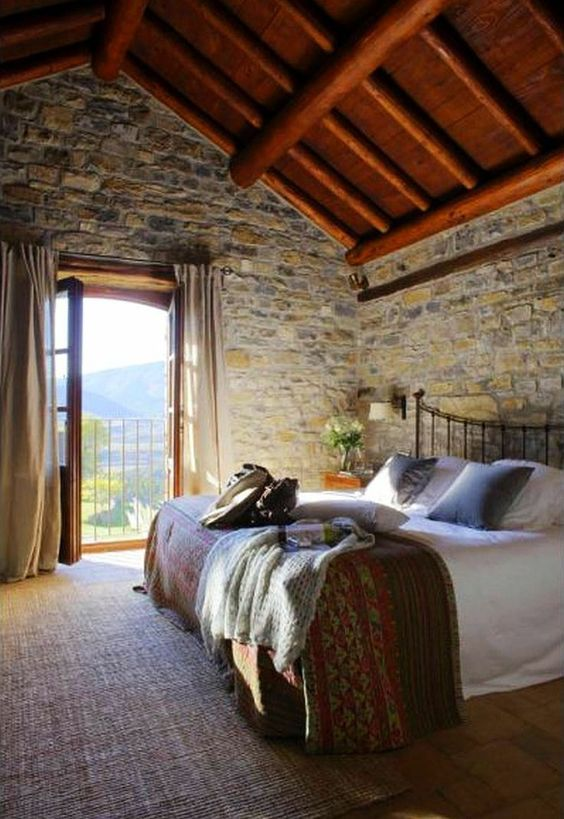 master bedroom with stone brick walls