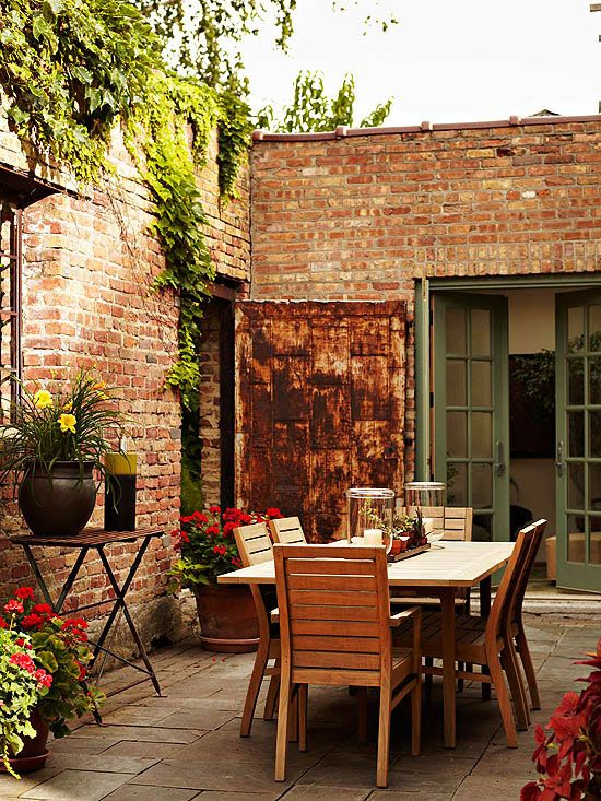 small patio with red brick walls