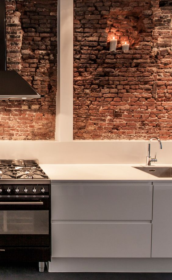 modern kitchen with red brick wall
