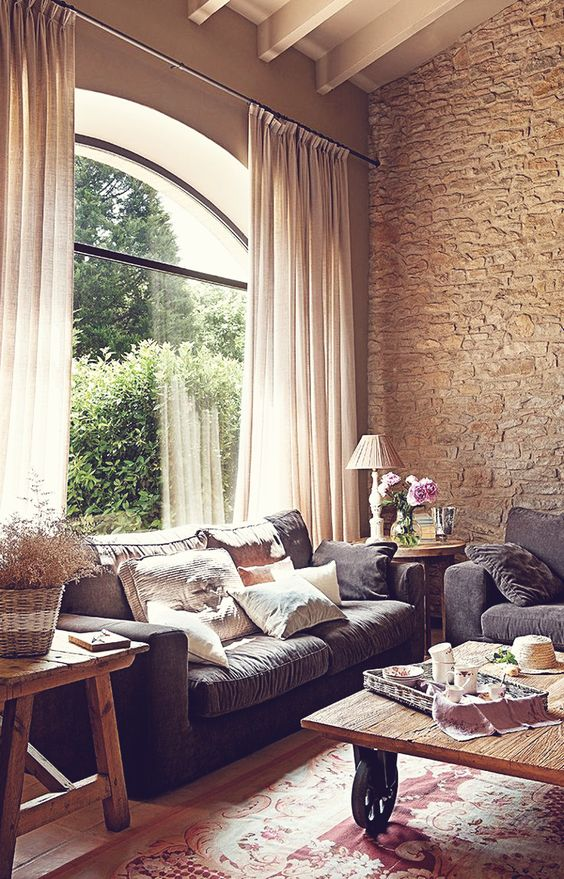 cosy living room with weathered stone wall
