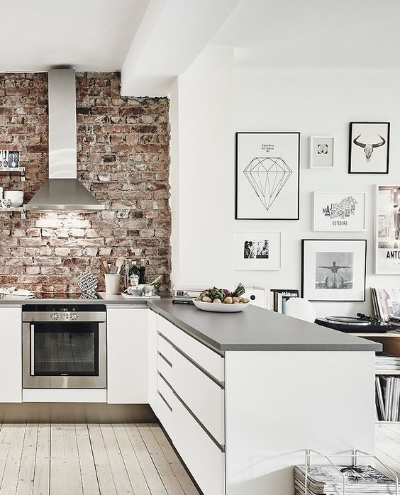 modern kitchen with brick wall