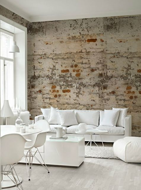 white living room with rough brick wall