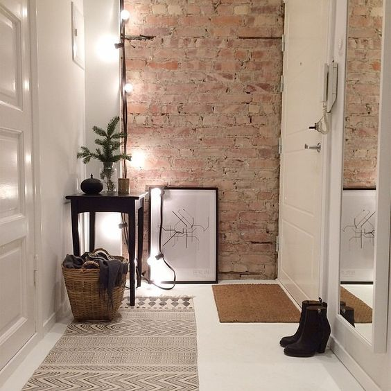 modern foyer with a brick wall
