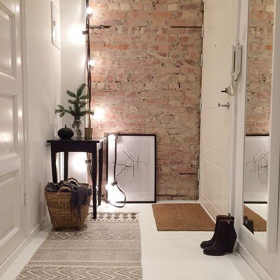 modern foyer with a brick wall