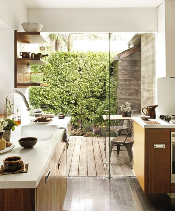 small kitchen with glass wall