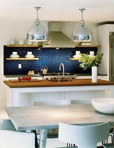 white kitchen with blue plashback