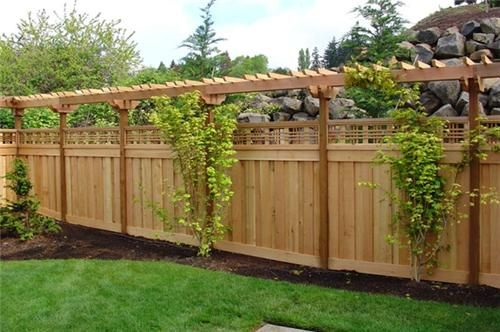 wood fence with arbour