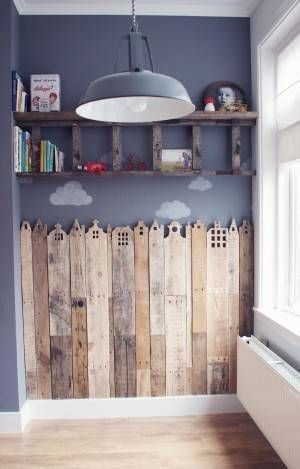 nursery room with pallet wood carvings