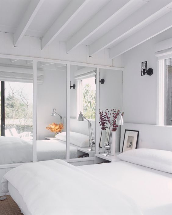 white and mirrored bedroom