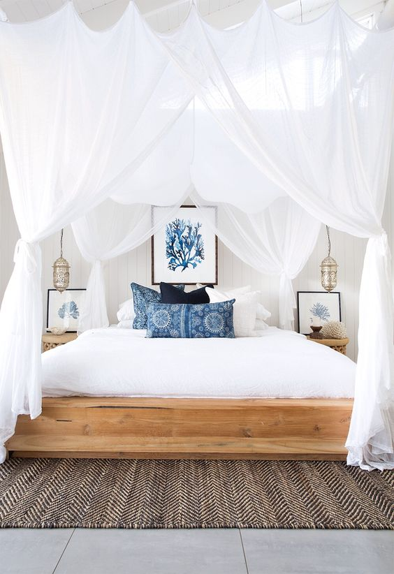 luxurious white canopied bedroom