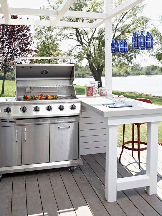 white cottage outdoor kitchen