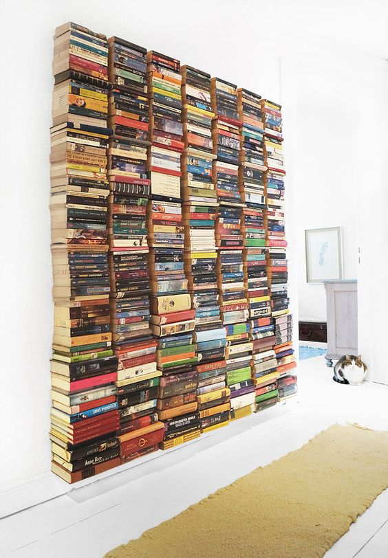 stacked books on wall