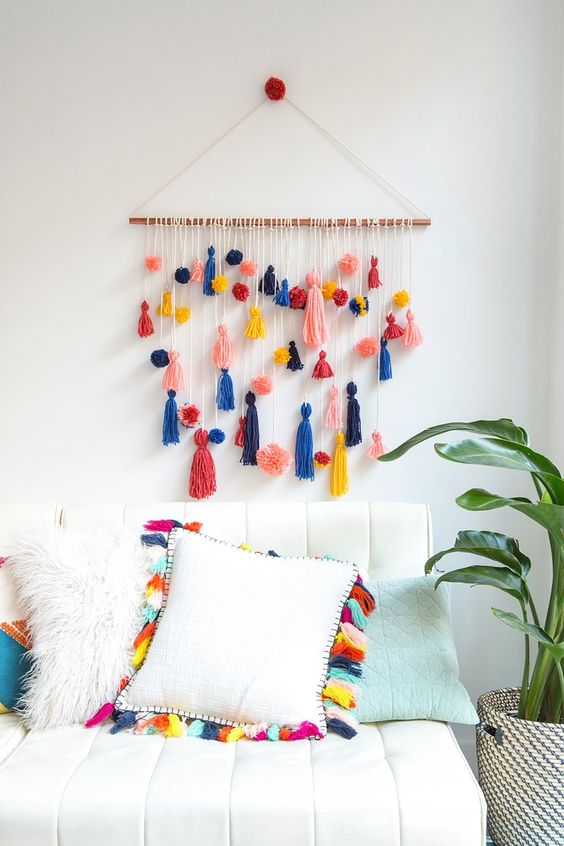 tassel and pompom wall feature