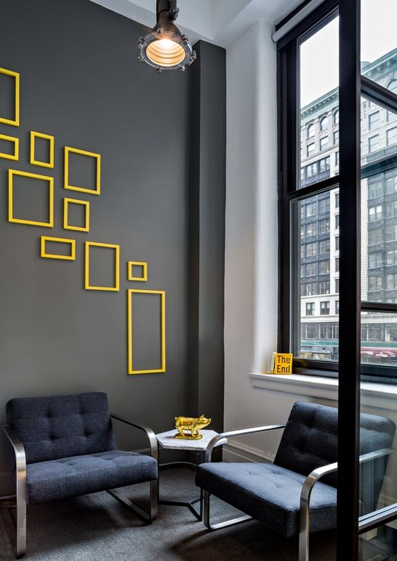 dark grey wall with yellow accents