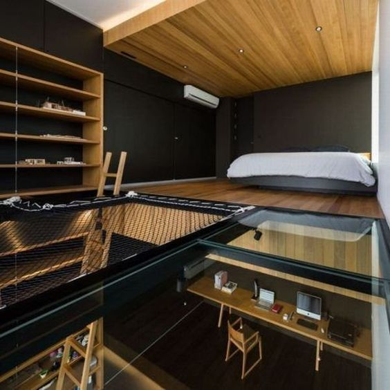 glass-floored loft bedroom