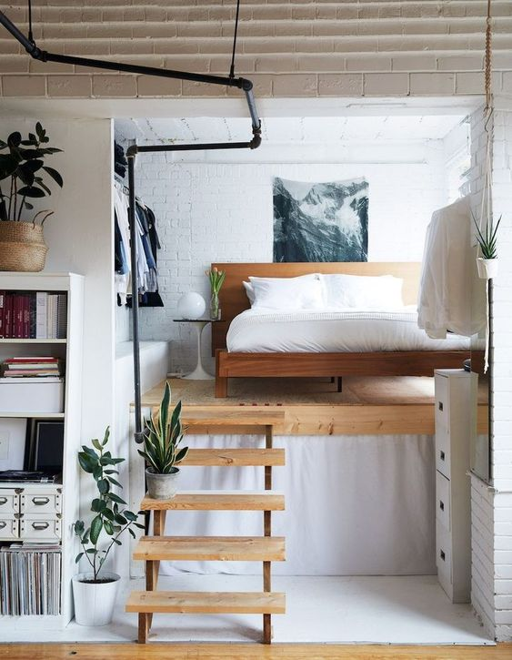 small apartment with raised bed