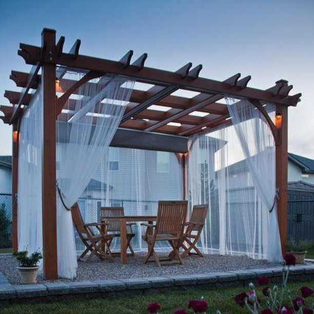 Infuse ethereal charm to your garden pergola by adding gauzy curtains to one or more sides. Use different curtain material to match your needs – thicker for more privacy, prints and colours for more vibrancy. 😍  #RenoGuide #Dining #OutdoorDining #OutdoorLiving #InteriorDesign #Pergola #ModernHomes #Design #Backyard