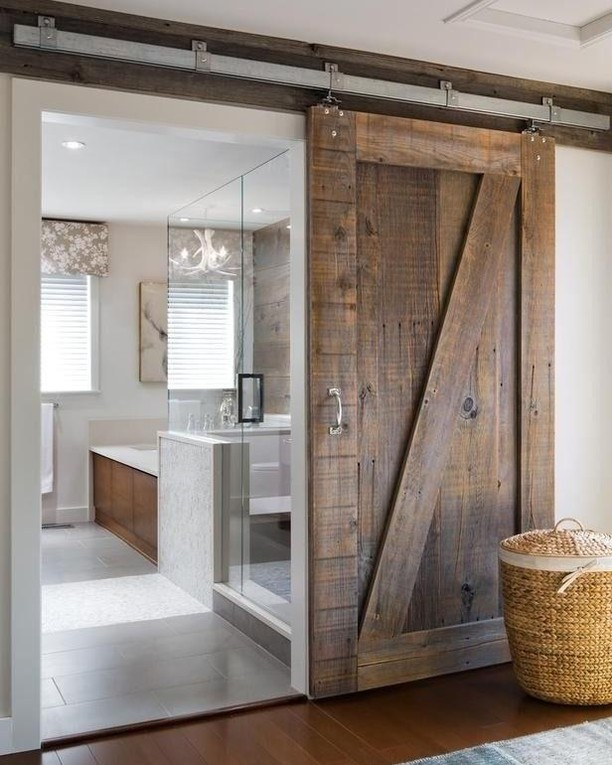 Barn sliding doors made from recycled wood planks are definitely on trend when it comes to contemporary bathroom interiors.  How beautiful are they? 😍😍 #️RenoGuide #ModernHomes #Upcycled #SlidingDoor #Interior #InteriorDesign #Design #Bathroom #HomeGoals #Goals #Statement