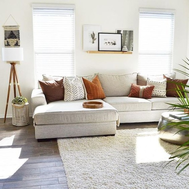 Relax in this clean, simple and streamlined family room. The design features soothing white interiors with a comfortable couch and a minimalist stylish rug. The vintage lamppost and shiny round table adds glam and sophistication.  #RenoGuide #Minimalist #Vintage #InteriorDesign #Loungeroom #LivingRoom #FamilyRoom #Home #HouseGoals #Design #Inspo #DesignInspo
