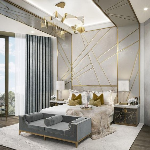 Anything plain and humdrum will never fail to look luxurious when touched by gold. This basic white and steel grey bedroom gets an opulent boost from some tasteful golden accents - pillow cases, gold insets in the wall and ceiling, gold touches on the furniture and a show-stopping gold chandelier. 💫😍 #RenoGuide #Bedroom #BedroomGoals #Goals #Luxury #BedroomInspo #InteriorDesign #Design #Inspo