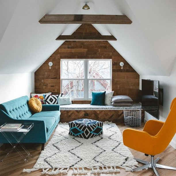 Reinvent your attic from boring to stunning! Bond with the whole family and enjoy your favourite movies or TV shows in this cosy attic retreat. The white interior is well-balanced with the sofa in a lovely shade of turquoise, while the zig-zag patterned rug and colourful footstool add a playful vibe to the room. The brick wood wall and exposed beam ceiling give the room its laidback styling.  #RenoGuide #Goals #LivingRoom #LoungeRoom #Mustard #ColourScheme #ColourTheme #InteriorDesign #Comfort #Style