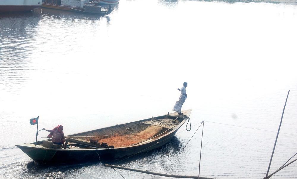Men on boat outside Dhaka