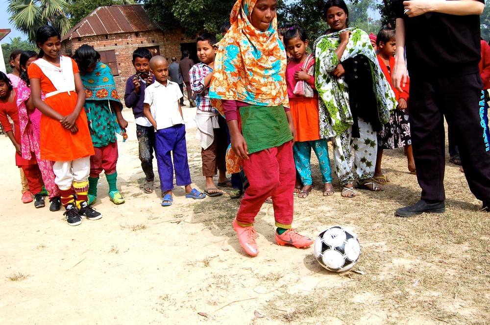 Girl learning soccer