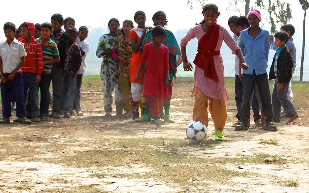 Village girls learning soccer