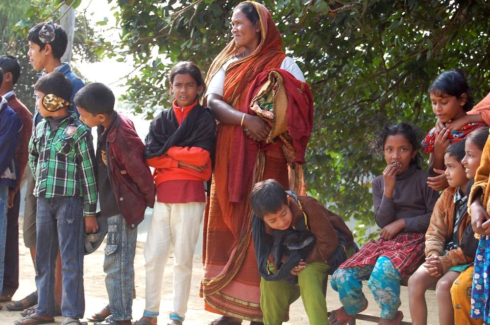 A mom watches her children