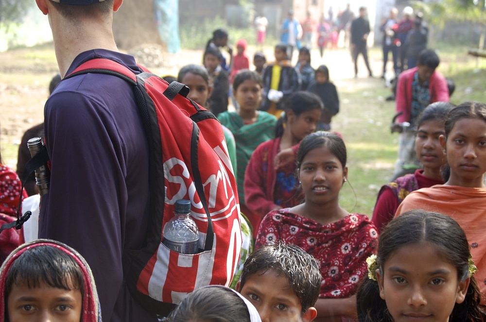 Village children following us