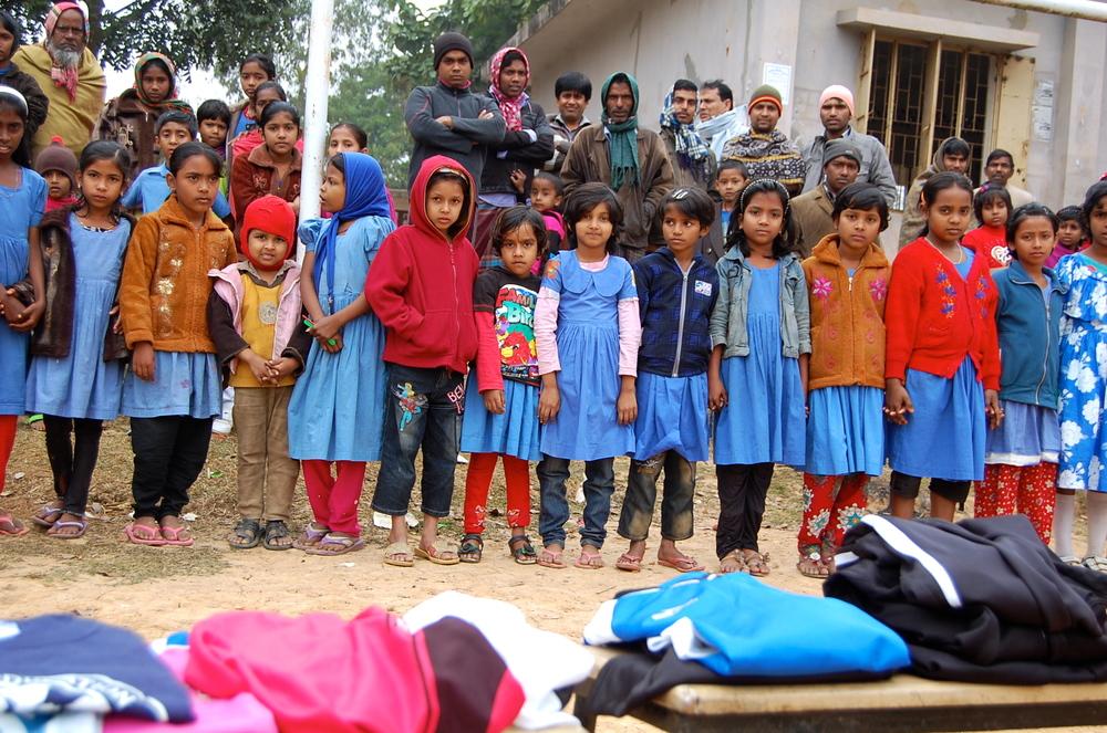 Village children waiting their new gear