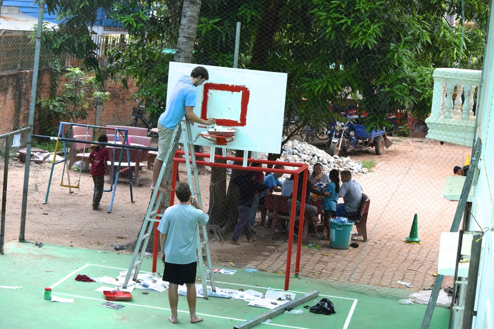 Patrick painting the backboard