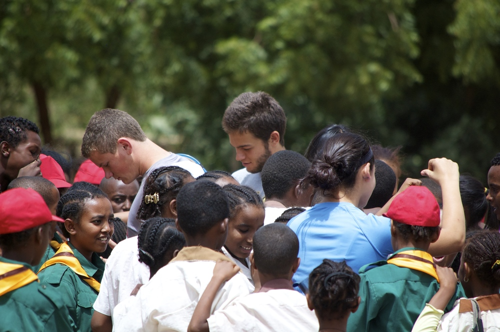 Matt and Sam talking with the school children