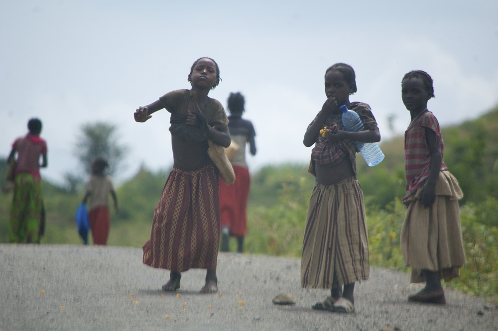 Children dancing on the roadside