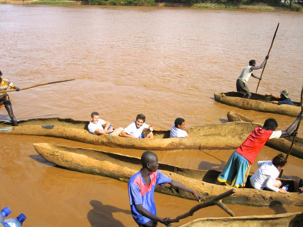 Taking a unique boat across the river to visit the Daasanach tribe