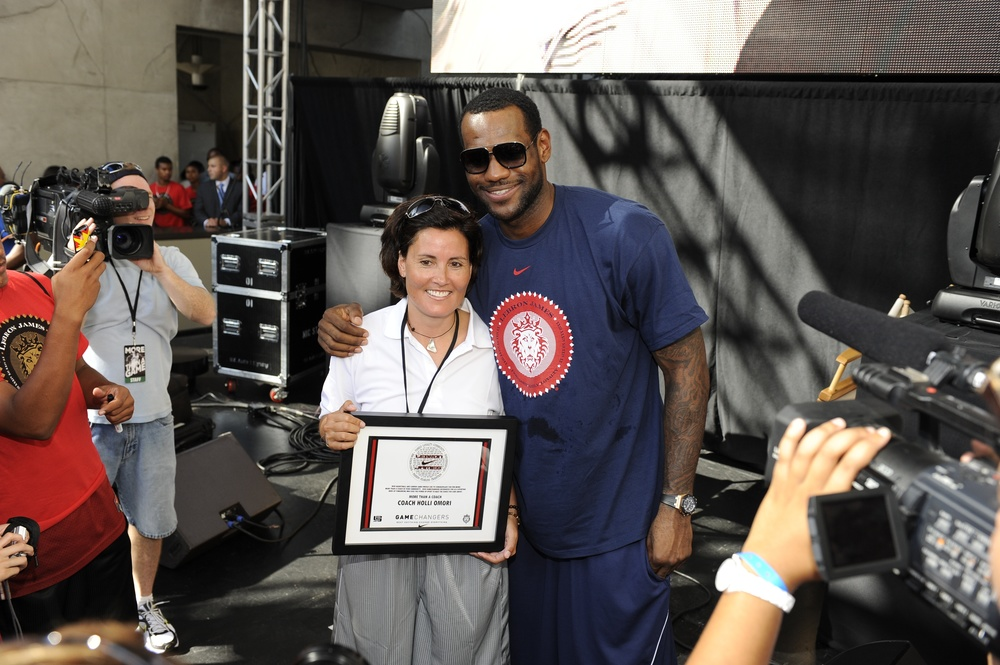 "Founder Holli Omori with LeBron James after winning the ""More Than A Coach"" award in Los Angeles."