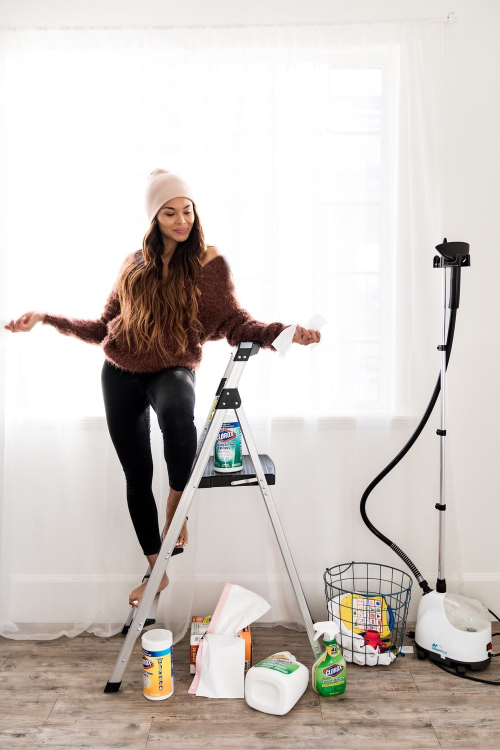 Top US lifestyle blog, Mom Crush Monday, shares their Top 3 Best Cleaning Tips: image of a woman sat on a ladder with Clorox products