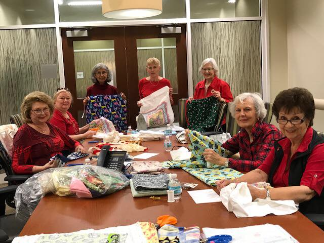 Members get together to sew pillowcases for Grandma's Place. Children use the cases to carry their belongings after their stay at the transitional foster center.