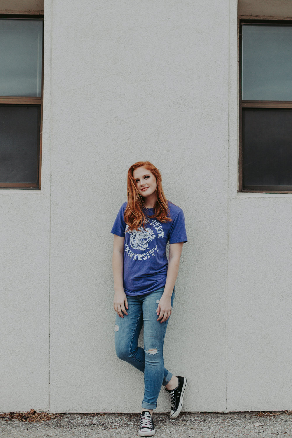 Senior pictures with college t-shirt.