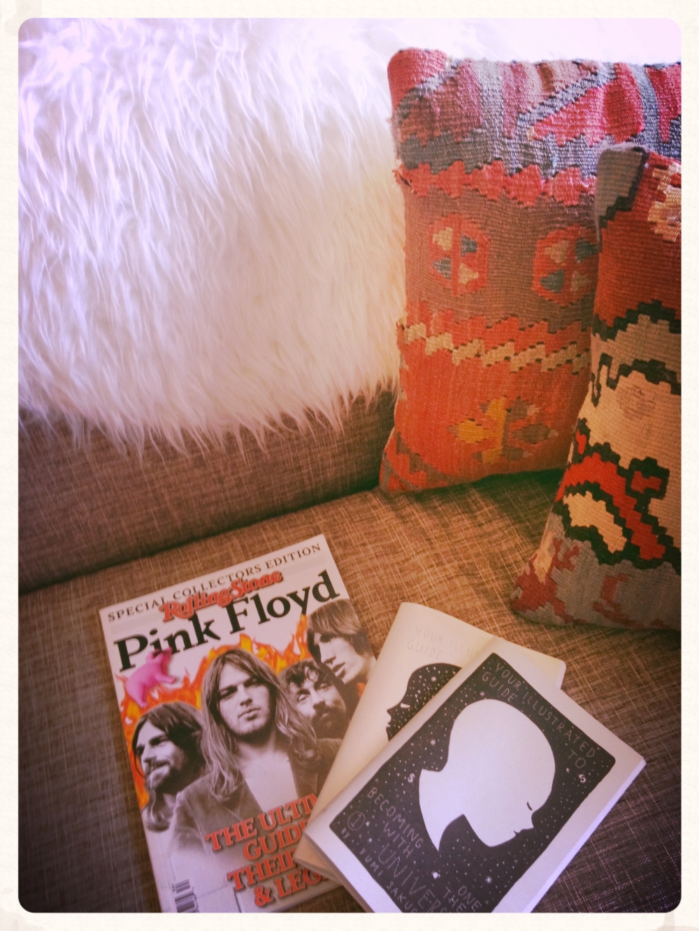 This was an accidental altar. Some reading material on Cara's couch, next to her fur throw, and her kilim pillows just kind of make her feel like a 1970s goddess. Heyyyyyyy, David Gilmore, I love you! xoxo, Cara