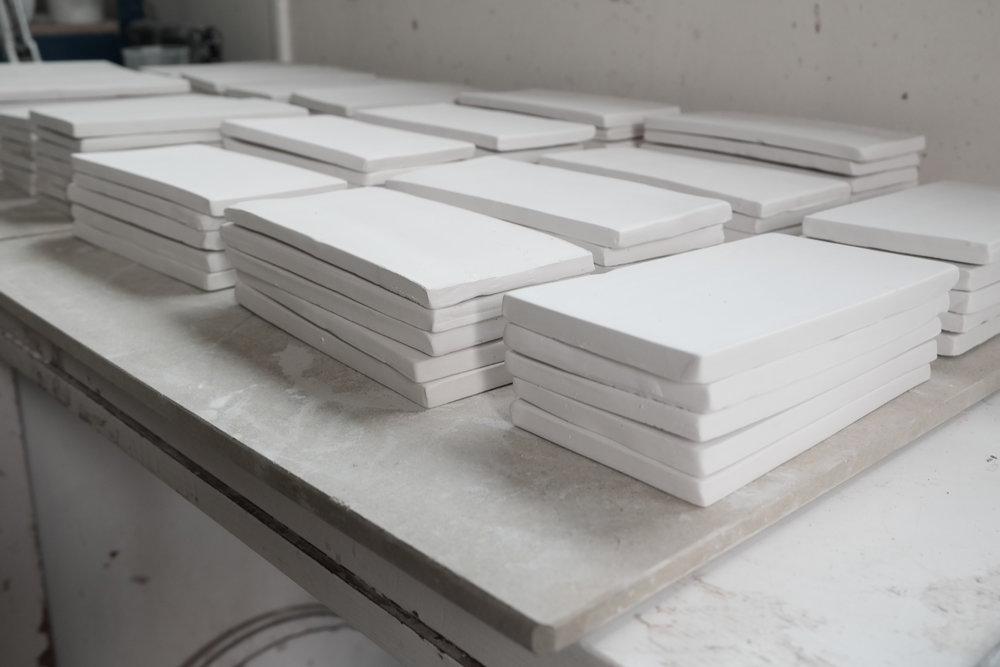 135 tiles freshly bisque fired waiting for the next stage...