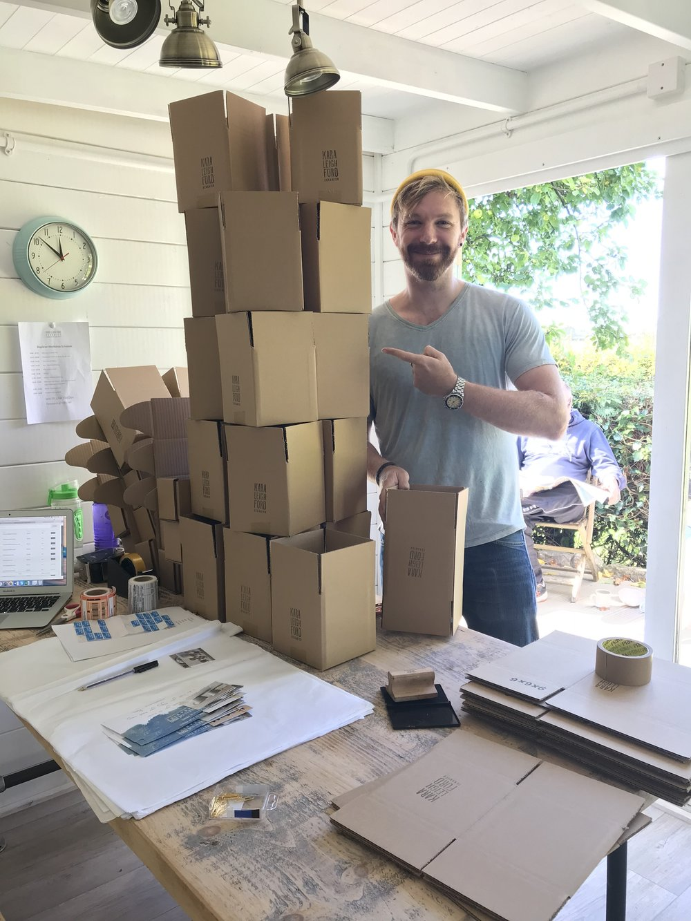 Thomas helping pack orders. Isn't he adorable?;-)