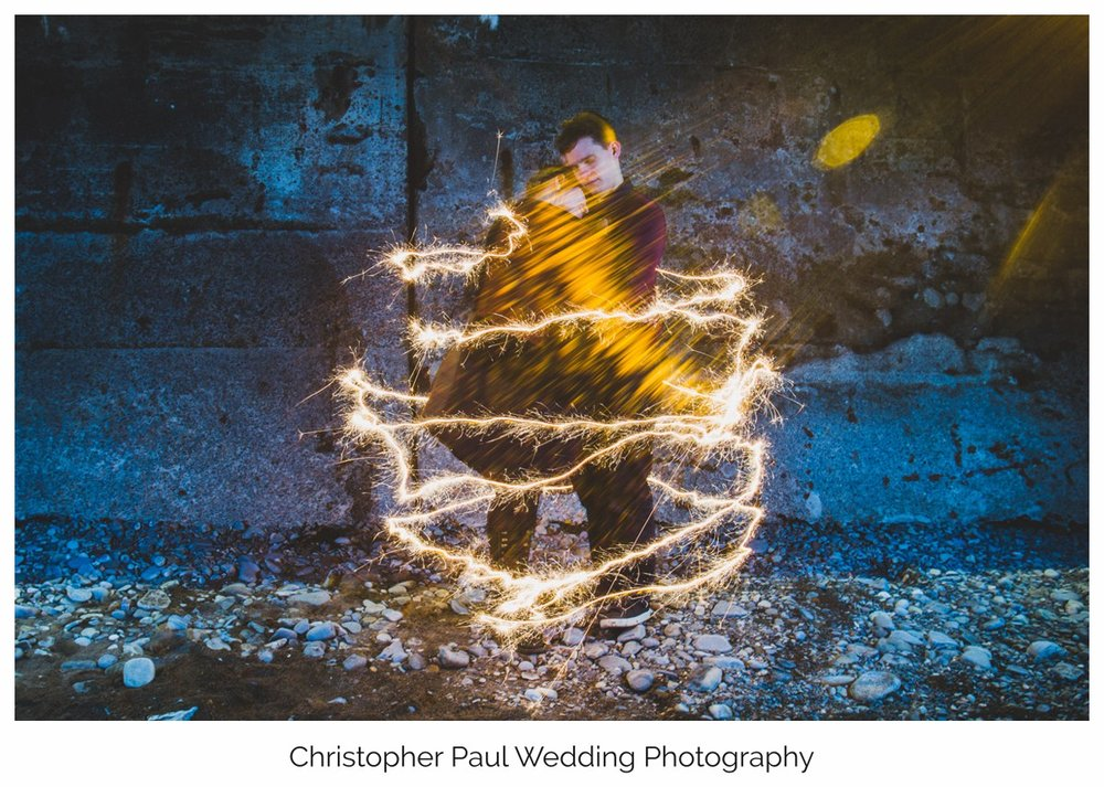 We did some light painting ideas with sparklers on Penarth Beach, it's great to be able to play around with some alternative wedding photography ideas. Cardiff Wedding Photographers
