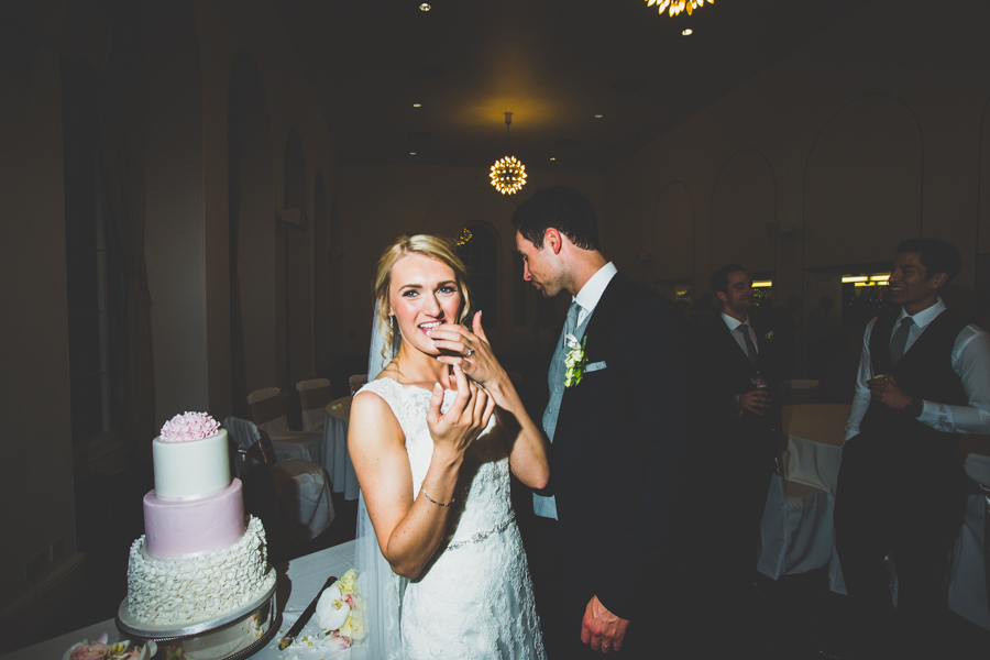 Bride and Groom eat their wedding cake at the Orangery in Margam, Wales
