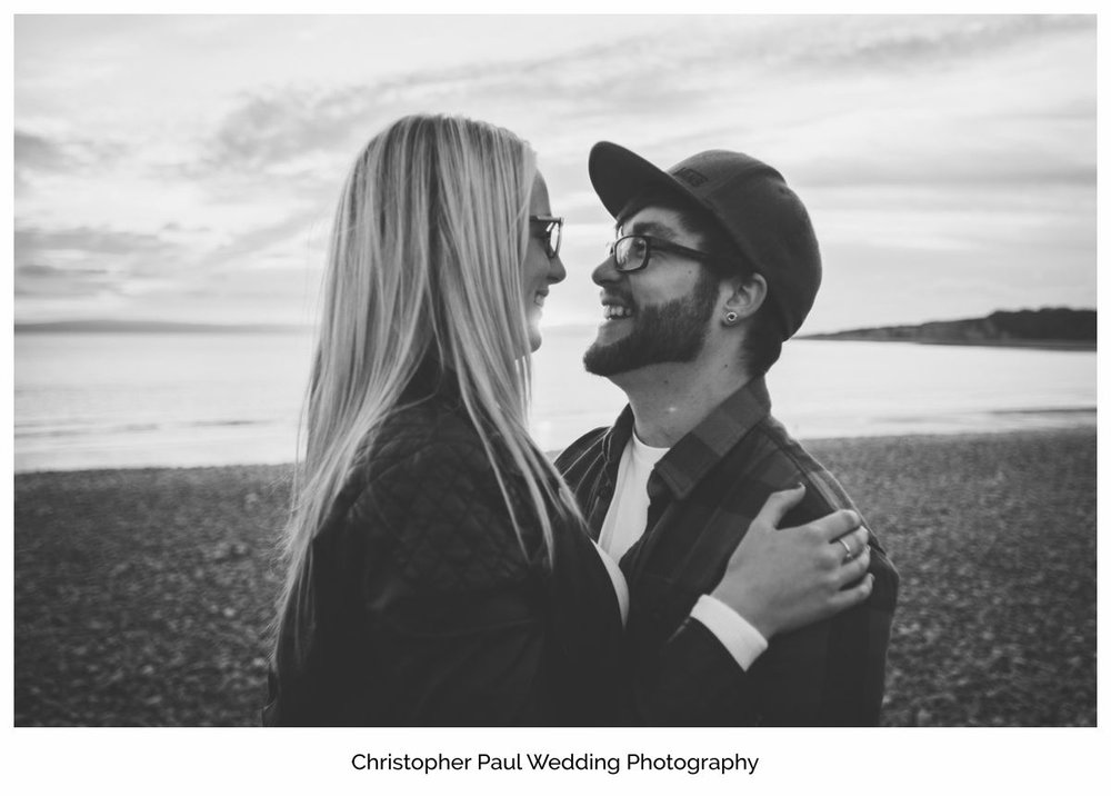 A beautiful engagement photo with the Barry Sunset behind, Cardiff Wedding Photographers