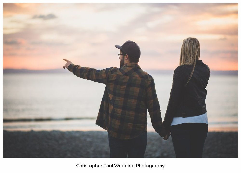 A beautiful engagement photo, the couple watch the sunset in Barry South Wales Cardiff Wedding Photographers