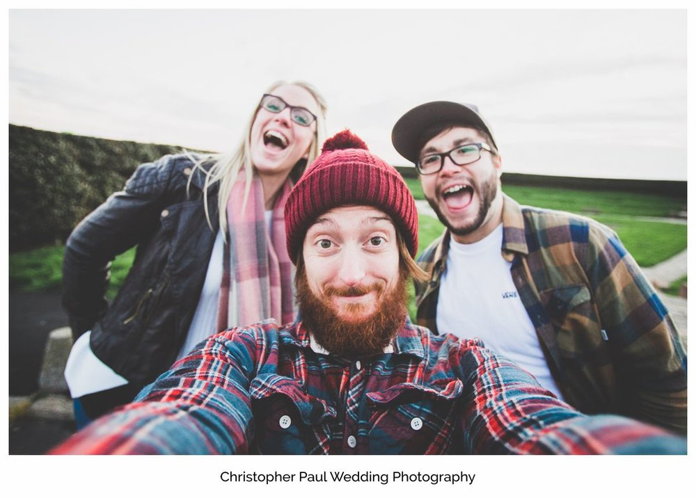 The wedding photographer takes a selfie with the bride and groom to be in Barry South Wales Wedding Photographers